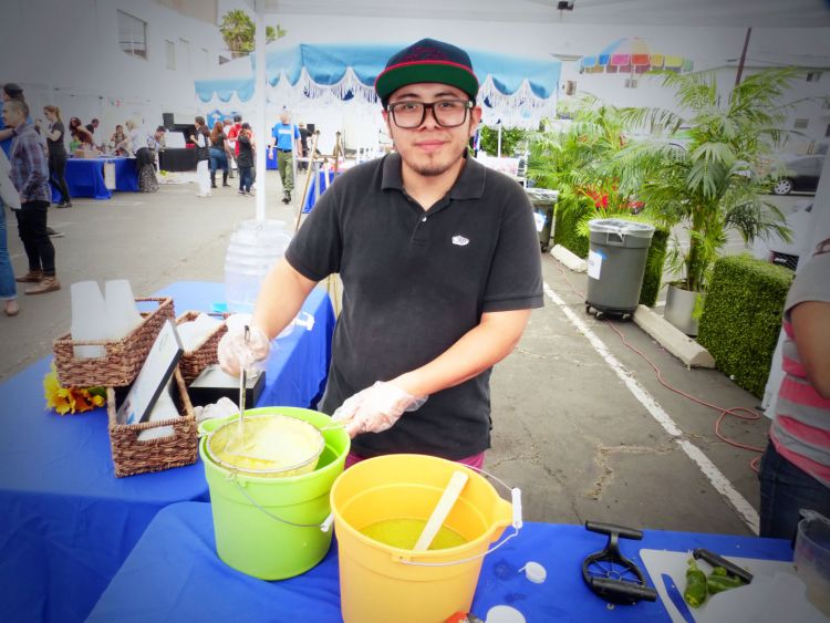 Ruandy Urbieta, owner of Misfit Lighting, served fresh organic jalapeno pineapple lemonade